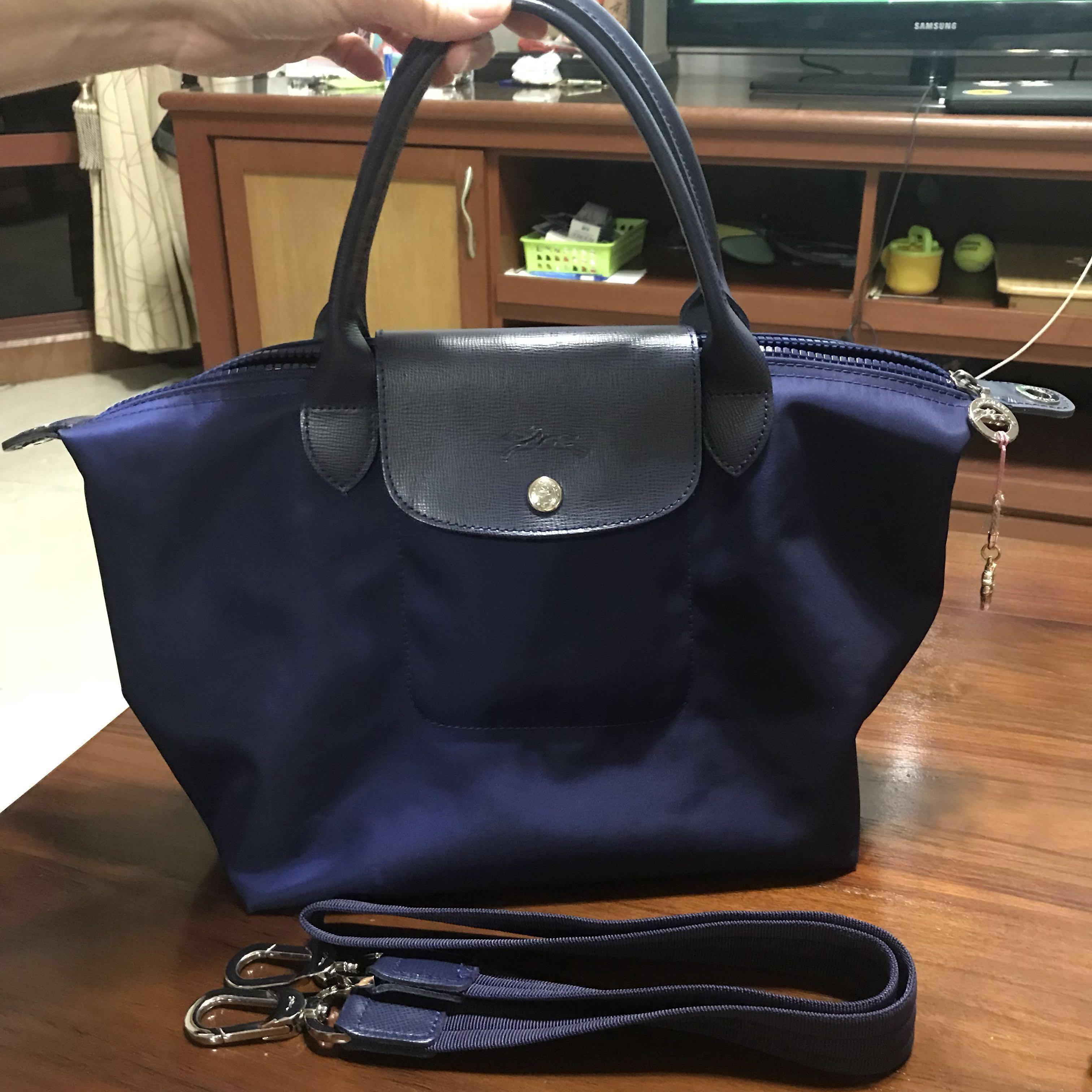 69114cd4c32 Authentic longchamp le pliage Neo medium navy blue, Women's Fashion, Bags &  Wallets, Handbags on Carousell