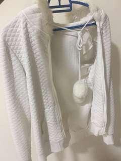 White furry travel jacket