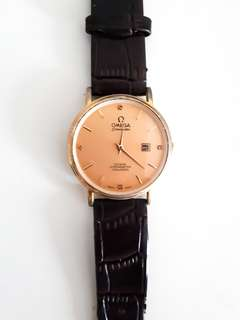 Gold faced OMEGA leather watch