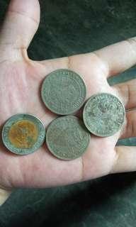 Uang logam 1000 kelapa sawit dan 100