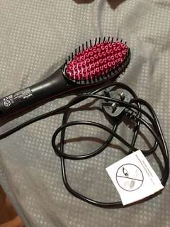 Comb straightener