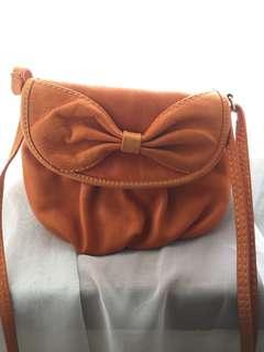 orange leather sling bag (beli di europe)