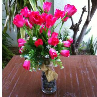 Artificial flower with vase. Vase is 20 x 8cm, flowers are 40 x 20cm.   In good condition.