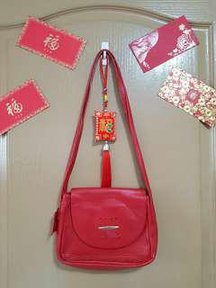 Bonia red genuine leather sling bag good for CNY