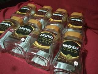 Empty Nescafe gold glass jars