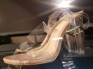 Clear straps nude shoes