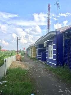 Dijual Tanah beserta 2Ruko Gandeng & 16 Pintu Rumah Sewa