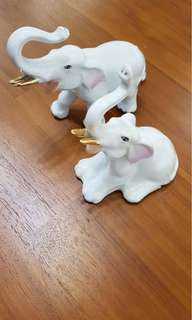 Ceramic elephants with pink ears n gold trunk