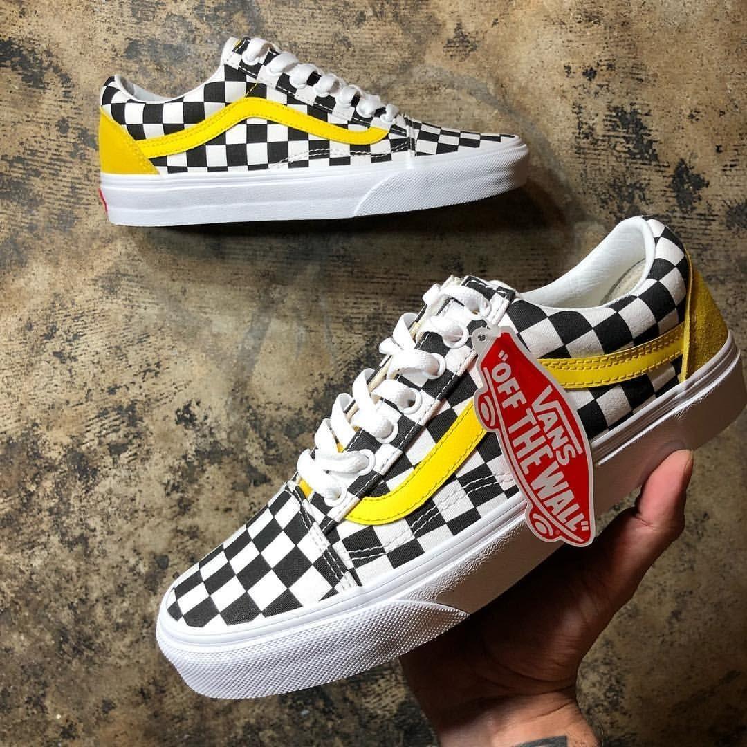 black vans with yellow stripe