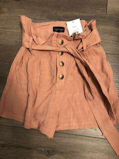 BLUSH PINK BUTTON SHORTS