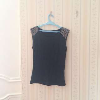 Folded and Hung Black Top