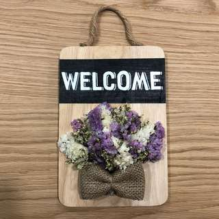 Welcome sign with real dried flowers