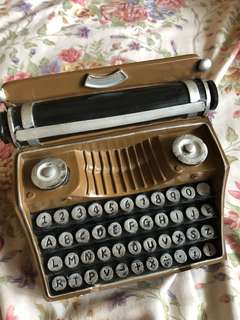 Vintage type writer piggy bank