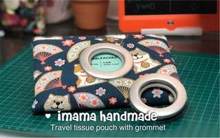 Travel tissue pouch with grommet. Design: 招财狗狗