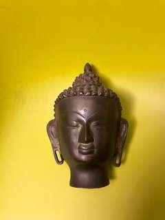 Solid bronze Buddha head