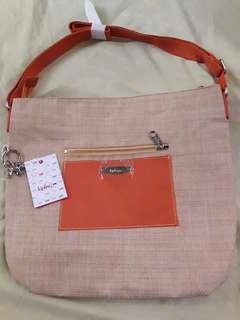 AUTH. KIPLING WOVEN SLING BAG. BRANDNEW WITH TAGS