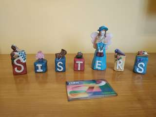 Porcelain dolls sisters