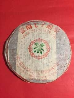 普洱茶餅: 1994 年野生葉青餅(如相片所示)