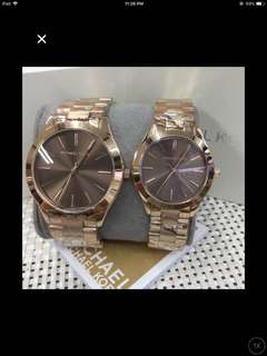 Authentic Michael kors couple pawnable