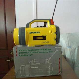 Portable radio/flashlight