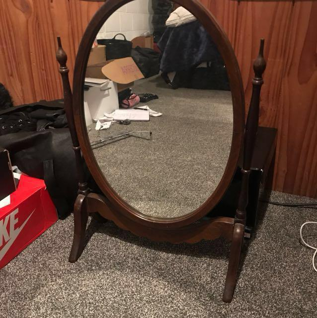 Old style standing wood mirror