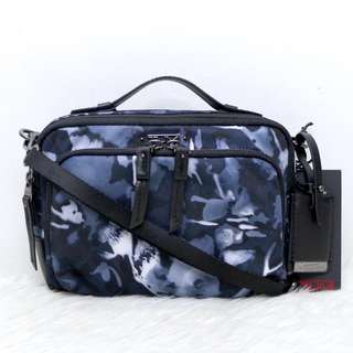 Tumi printed double zip sling bag