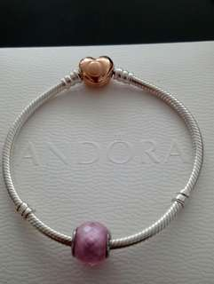 Authentic Pandora bracelet with rose gold clasp and charm.
