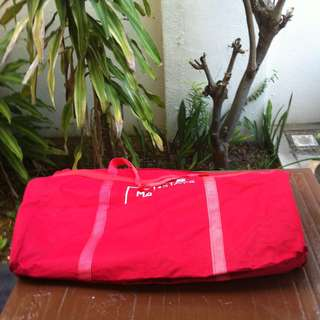 Red and coloured Storage bags. The red one is 70 x 50 x 30cm. The coloured one is 50 x 17 x 37cm. Both in good  condition. Price is for the two bags.