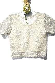 Cream colored crochet-like top