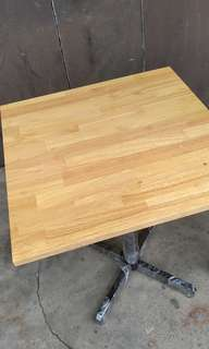 Solid rubber wood top with mild steel table base