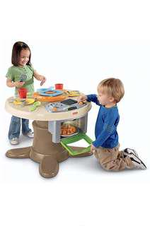Fisher price servings' surprises table and kitchen set