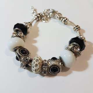 Silver, white and black charm bracelet