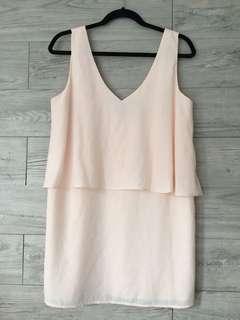 Peach-colored layered mini-dress