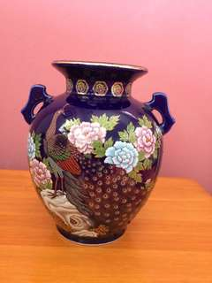 Ceramic pot in blue with peacock and flowers