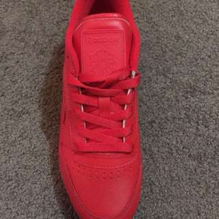 Red Reebok sneakers