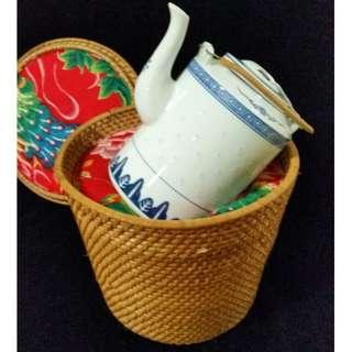 Teapot in basket