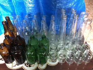 Assorted empty glass bottles