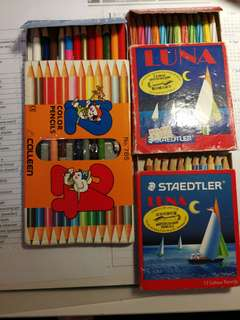 Colour Pencils and notebook