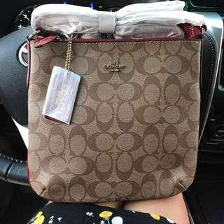 Authentic cross body bag