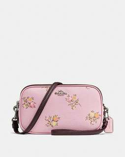 loading...  crossbody clutch with cross stitch floral print. Style no. 22836