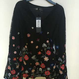 Zalia Embroidered lace wrap peplum top