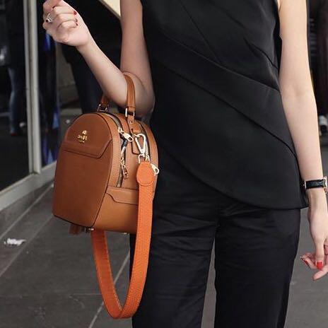 Orange snakeskin bag strap