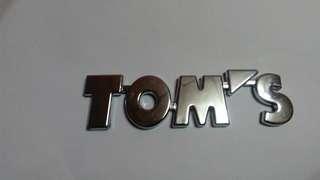 Tom's car logo