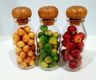Glass bottles with Apples