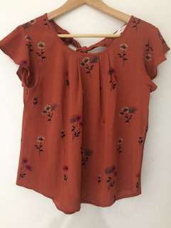 Orange tied back blouse