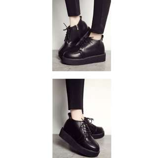 Black leather boots shoes