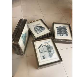 Framed pictures of Swiss farm houses