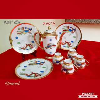 1950s Hand-painted Pheonix and Dragon Teaset (Teapot + 4 cups + 3 plates), no saucers. Unused, Good Condition. Do refer to photo for size. Good  Condition, unused. All 8 items for $18 Clearance Offer. sms 96337309.