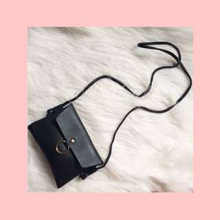 Black and gold faux leather sling bag