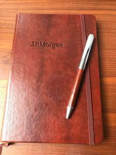 BN brown leather bound notebook lined by JP morgan and BN pen